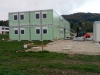 Wohncontaineranlage, bestehend aus 32 St. Container, inkl. Sanitär und Treppenanlage.